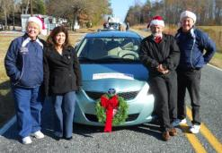 "December 2010 in the Pleasant Garden Christmas Parade with our friends, Linda and Earl Dorman. We had a blast tossing ""poopsie rolls"" to the folks along the parade route.."